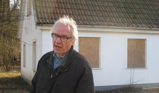 Swedish artist Lars Vilks speaks during an interview with The Associated Press in Malmo, Sweden, Wednesday, March 4, 2015. Vilks, who had lived under police protection since his 2007 sketch of the Prophet Muhammad with a dog's body brought death threats, died from a traffic accident Sunday, Oct. 3, 2021, Swedish news media reported. (AP Photo/David Keyton)