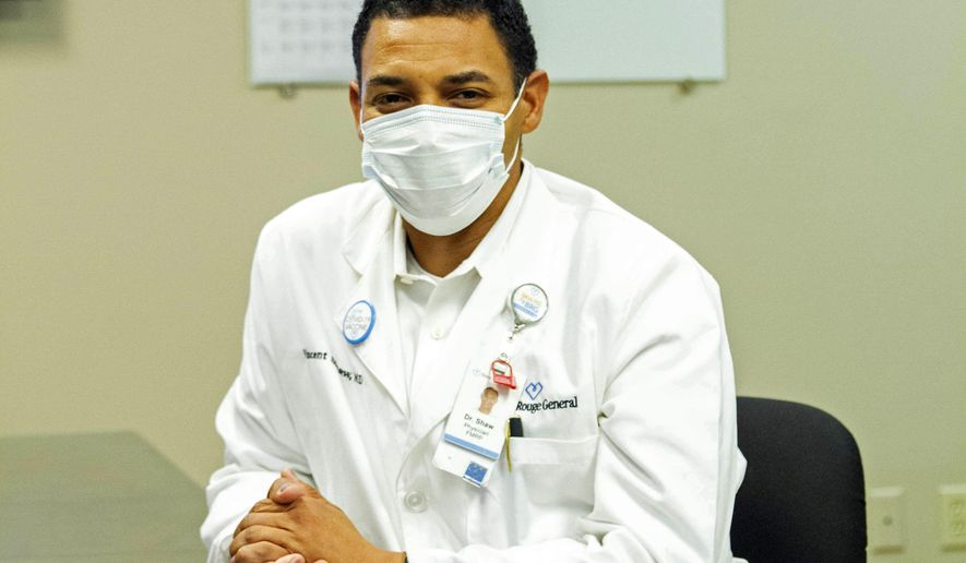 Dr. Vincent Shaw poses for a portrait in Baton Rouge, La., Wednesday, Sept. 29, 2021. He commonly hears patients tell him they haven't done enough research on the COVID-19 vaccines. Rest assured, he tells them, the vaccine developers have done their homework.  (AP Photo/Dorthy Ray)