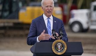 """President Joe Biden delivers remarks on his """"Build Back Better"""" agenda during a visit to the International Union Of Operating Engineers Local 324, Tuesday, Oct. 5, 2021, in Howell, Mich. (AP Photo/Evan Vucci) **FILE**"""