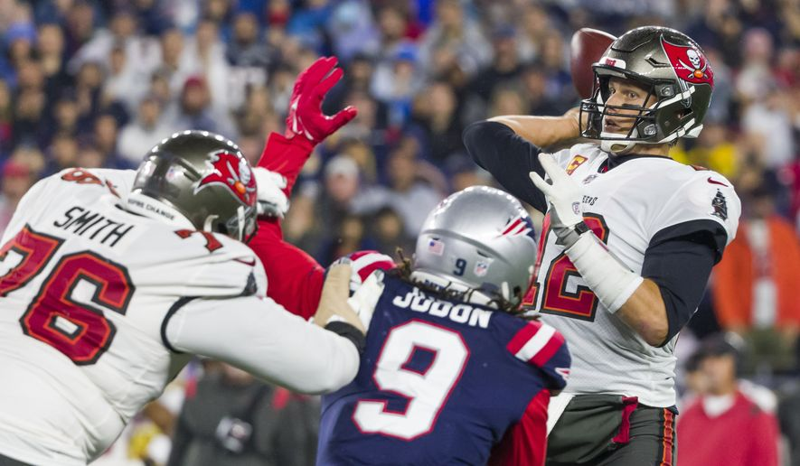 Tampa Bay Buccaneers quarterback Tom Brady (12) prepares to make a pass while pressured by New England Patriots outside linebacker Matt Judon (9) during the first half of an NFL football game, Sunday, Oct. 3, 2021, in Foxborough, Mass. (AP Photo/Greg M. Cooper)