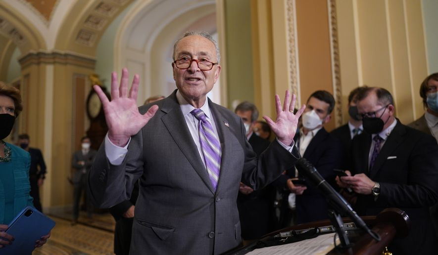 Senate Majority Leader Chuck Schumer, D-N.Y., speaks to reporters after a Democratic policy meeting at the Capitol in Washington, Tuesday, Oct. 5, 2021. (AP Photo/J. Scott Applewhite) ** FILE **