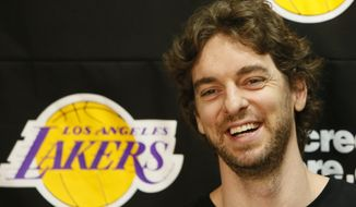 In this April 30, 2013 file photo, Los Angeles Lakers power forward Pau Gasol smiles while talking to reporters during an NBA basketball news conference in El Segundo, Calif. Pau Gasol announced his retirement from basketball on Tuesday,  Oct. 5, 2021, ending a career that lasted more than two decades and earned him two NBA titles and a world championship gold with Spain's national team. (AP Photo/Damian Dovarganes, File) **FILE**