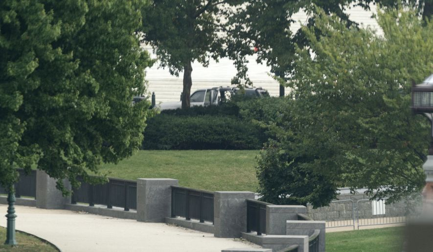 A suspicious vehicle is investigated in front of the Supreme Court, Tuesday, Oct. 5, 2021, in Washington. (AP Photo/Alex Brandon)