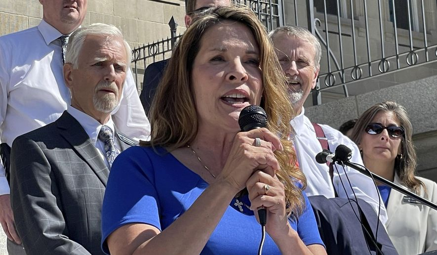 In this Sept. 15, 2021, file photo Republican Lt. Gov. Janice McGeachin addresses a rally on the Statehouse steps in Boise, Idaho. (AP Photo/Keith Ridler, File)