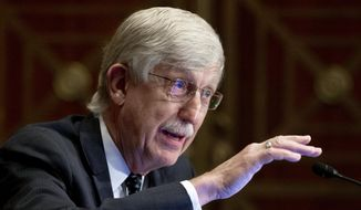 Dr. Francis Collins, director of the National Institutes of Health, appears before a Senate Health, Education, Labor and Pensions Committee hearing to discuss vaccines and protecting public health during the coronavirus pandemic on Capitol Hill, on Wednesday, Sept. 9, 2020, in Washington. Collins says he is stepping down by the end of the year, having led the research center for 12 years and becoming a prominent source of public information during the coronavirus pandemic. A formal announcement was expected Tuesday, Oct. 5, 2021, from NIH. (Michael Reynolds/Pool via AP, File)