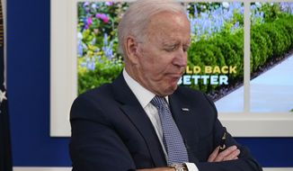President Joe Biden listens during a meeting with business leaders about the debt limit in the South Court Auditorium on the White House campus, Wednesday, Oct. 6, 2021, in Washington. (AP Photo/Evan Vucci)