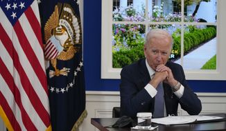 President Joe Biden listens during a meeting with business leaders about the debt limit in the South Court Auditorium on the White House campus, Wednesday, Oct. 6, 2021, in Washington. (AP Photo/Evan Vucci) **FILE**
