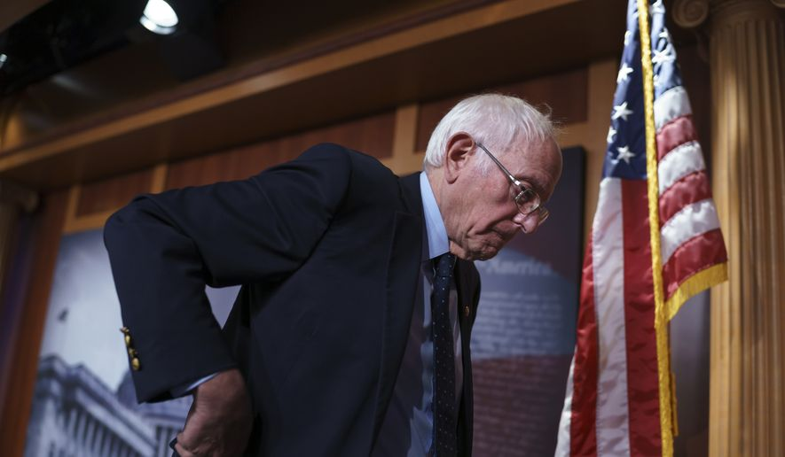 Senate Budget Committee Chairman Bernie Sanders, I-Vt., talks to reporters as Democrats work on a way to lift the debt limit and find a way to pass President Joe Biden's domestic agenda, at the Capitol in Washington, Wednesday, Oct. 6, 2021. Sanders was critical of Democratic Sen. Joe Manchin, of West Virginia, a key holdout vote on the Biden overhaul. (AP Photo/J. Scott Applewhite)