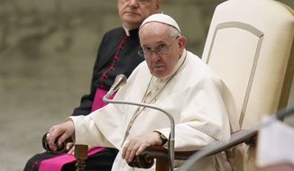 Pope Francis listens to speeches during his weekly general audience in the Pope Paul VI hall at the Vatican, Wednesday, Oct. 6, 2021. (AP Photo/Alessandra Tarantino)