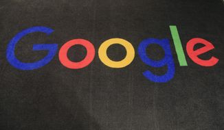 In this Nov. 18, 2019, file photo, the logo of Google is displayed on a carpet at the entrance hall of Google France in Paris. A new search feature rolled out Wednesday, Oct. 6, 2021, tells users which flights have lower carbon emissions, giving them the ability to choose flights based on carbon emissions just as they would price or the number of layovers. (AP Photo/Michel Euler, File)