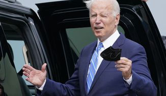 President Joe Biden responds to a question about the short term deal on debt as he arrives Air Force One at O'Hare International Airport in Chicago, Thursday, Oct. 7, 2021. While in the Chicago area, Biden will highlight his order to require large employers to mandate COVID-19 vaccines for its workers during a visit to a construction site. (AP Photo/Susan Walsh)