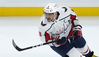 Washington Capitals left wing Alex Ovechkin (8) during the first period of an NHL preseason hockey game in Boston, Wednesday, Oct. 6, 2021. (AP Photo/Charles Krupa) **FILE**