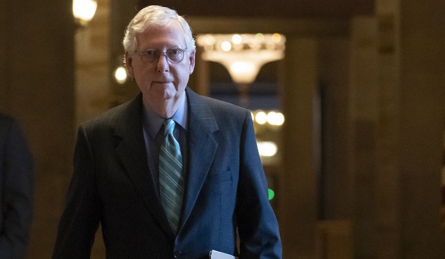 Senate Minority Leader Mitch McConnell, R-Ky., leaves the chamber after speaking, at the Capitol in Washington, Thursday, Oct. 7, 2021. Republican and Democratic senators have edged back from a perilous standoff over lifting the nation's borrowing cap and will likely extend the deadline until December. (AP Photo/Alex Brandon)