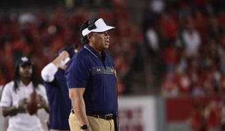 Navy head coach Ken Niumatalolo stands on the sideline during the second half of an NCAA college football game against Houston, Saturday, Sept. 25, 2021, in Houston. (AP Photo/Justin Rex) **FILE**