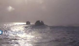 This frame grab from video aired by Islamic Republic of Iran Broadcasting, IRIB, state-run TV, on Thursday, Oct. 7, 2021, shows two vessels in the Persian Gulf. Iran's state TV reported that speedboats belonging to the country's paramilitary Revolutionary Guard have intercepted a U.S. vessel in the Persian Gulf. A U.S. Navy spokesman said he was not aware of any such encounter at sea over the past days. (IRIB via AP)