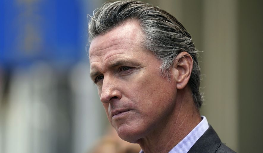 California Gov. Gavin Newsom listens to questions during a news conference in San Francisco. On Friday, Oct. 8, 2021. (AP Photo/Eric Risberg, File)