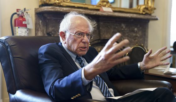 In this file photo, Senate Budget Committee Chairman Bernie Sanders, I-Vt., takes questions from reporters about the politics surrounding the debt limit vote this week, and about the way forward on on President Joe Biden's domestic agenda, at the Capitol in Washington, Friday, Oct. 8, 2021. (AP Photo/J. Scott Applewhite)