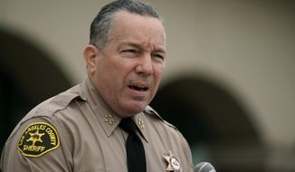 In this Sept. 10, 2020, file photo Los Angeles County Sheriff Alex Villanueva speaks at a news conference in Los Angeles. Villanueva says he will not enforce the county's vaccine mandate in his agency. Villanueva, who oversees the largest sheriff's department in the county with roughly 18,000 employees, said Thursday, Oct. 7, 2021, in a Facebook Live event that he does not plan to carry out the county's mandate, under which Los Angeles County employees had to be fully vaccinated by Oct. 1, 2021. (AP Photo/Jae C. Hong,File)