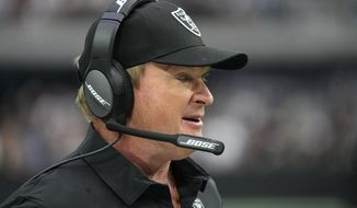 Las Vegas Raiders head coach Jon Gruden stands on the sidelines during the first half of an NFL football game against the Miami Dolphins, Sunday, Sept. 26, 2021, in Las Vegas. (AP Photo/Rick Scuteri)