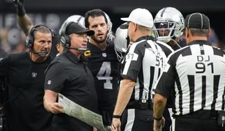 Las Vegas Raiders head coach Jon Gruden speaks with officials during the second half of an NFL football game against the Miami Dolphins, Sunday, Sept. 26, 2021, in Las Vegas. (AP Photo/Rick Scuteri) **FILE**