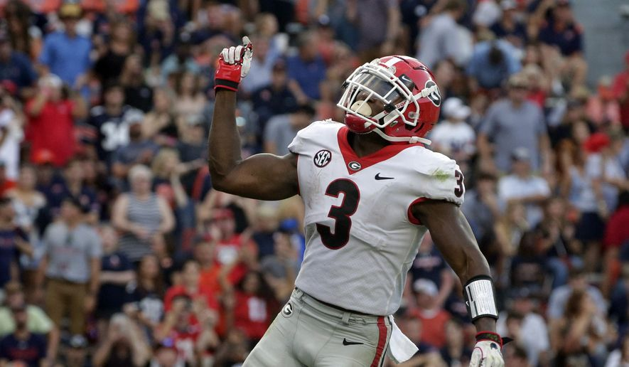 Georgia running back Zamir White (3) celebrates after a touchdown against Auburn during the second half of an NCAA college football game Saturday, Oct. 9, 2021, in Auburn, Ala. (AP Photo/Butch Dill) **FILE**