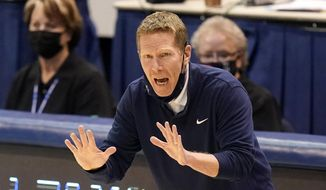 In this Feb. 8, 2021, file photo, Gonzaga head coach Mark Few shouts to his team during the second half of an NCAA college basketball game against BYU in Provo, Utah. Few will miss two exhibition games and the first game of the regular season after he was arrested last month on suspicion of driving under the influence, the school announced Saturday, Oct. 9, 2021. (AP Photo/Rick Bowmer, File) **FILE**