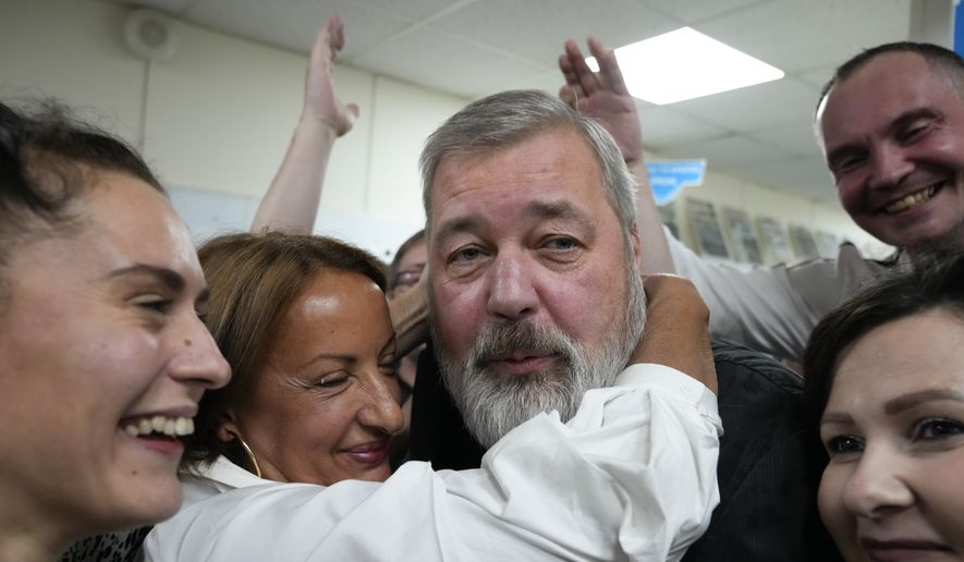 Colleagues congratulate Novaya Gazeta editor Dmitry Muratov at the Novaya Gazeta newspaper, in Moscow, Russia, Friday, Oct. 8, 2021. As a new Nobel Peace Prize laureate, Russian newspaper editor Muratov has downplayed the buzz around his name. The award isn't for him, he says, but for all of the staff at Novaya Gazeta, the independent Russian newspaper noted for investigations of official corruption, human rights abuses and Kremlin criticism. (AP Photo/Alexander Zemlianichenko)