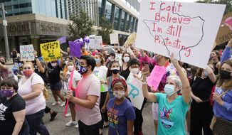 In this Oct. 2, 2021, file photo, people participate in the Houston Women's March against Texas' abortion ban from Discovery Green to City Hall in Houston. (Melissa Phillip/Houston Chronicle via AP, File)