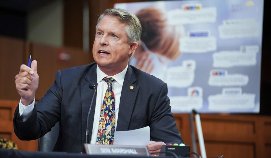 """FILE - In this Sept. 20, 2021, file photo, Sen. Roger Marshall, R-Kan., speaks during a Senate Health, Education, Labor, and Pensions Committee hearing to discuss reopening schools during the COVID-19 pandemic on Capitol Hill in Washington. Marshall won't let people forget he's a doctor by putting """"Doc"""" in the letterhead of his U.S. Senate office news releases. But when it comes to COVID-19 vaccines, other doctors think he sounds far less like a doctor and far more like a politician rallying hard-right supporters. (Greg Nash/Pool via AP, File)"""
