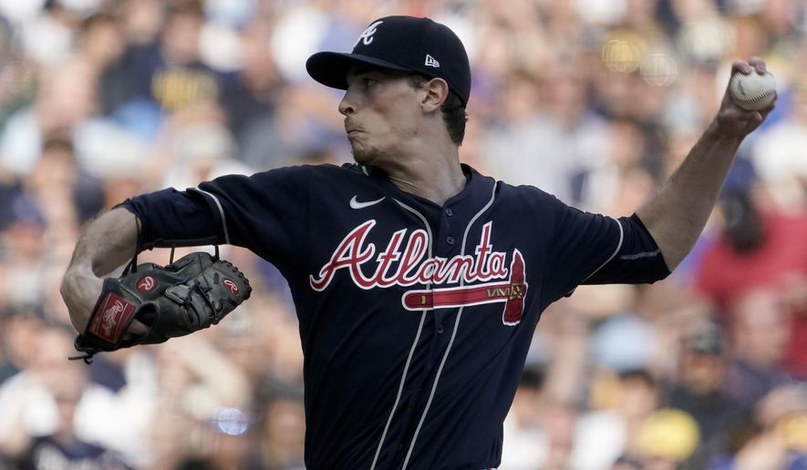 Atlanta Braves starting pitcher Max Fried throws against the Milwaukee Brewers during the first inning in Game 2 of baseball's National League Divisional Series Saturday, Oct. 9, 2021, in Milwaukee. (AP Photo/Morry Gash)