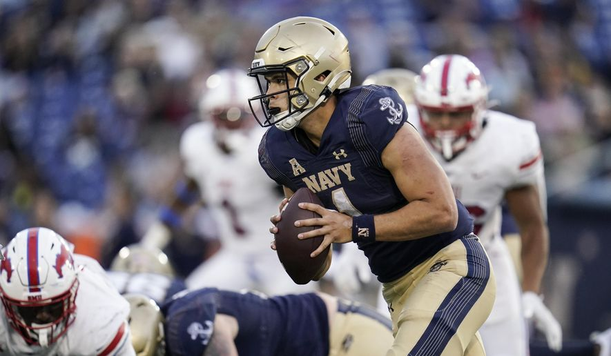Navy quarterback Tai Lavatai runs with the ball against SMU during the second half of an NCAA college football game, Saturday, Oct. 9, 2021, in Annapolis, Md. SMU won 31-24. (AP Photo/Julio Cortez)
