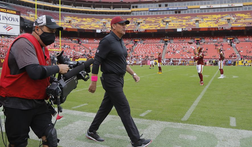 Washington Football Team head coach Ron Rivera walks on the field before an NFL football game against the New Orleans Saints, Sunday, Oct. 10, 2021, in Landover, Md. (AP Photo/Julio Cortez)