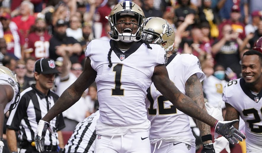 New Orleans Saints wide receiver Marquez Callaway (1) celebrates after making a touchdown catch in the first half of an NFL football game against the Washington Football Team, Sunday, Oct. 10, 2021, in Landover, Md. (AP Photo/Al Drago)
