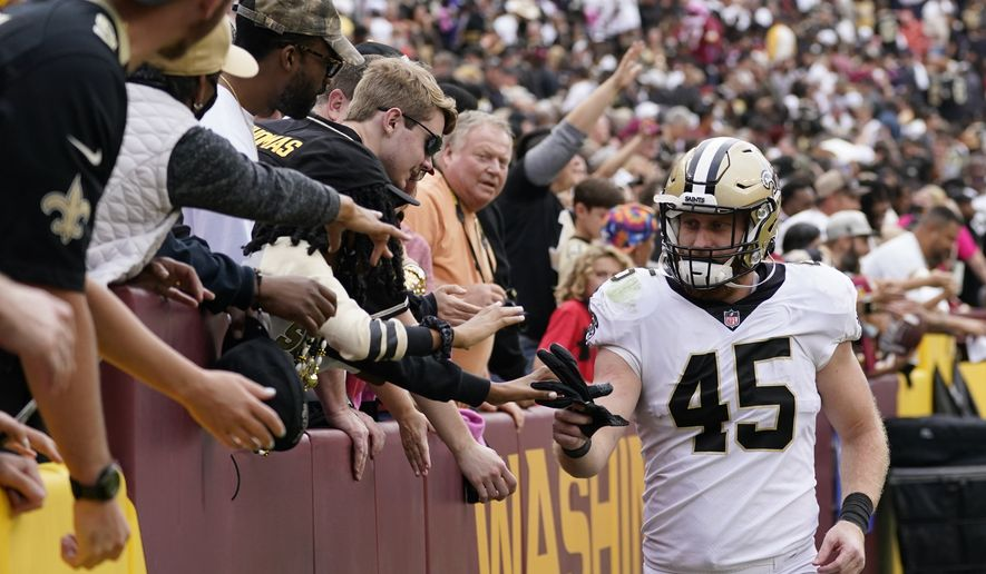 New Orleans Saints tight end Garrett Griffin celebrates with fans after an NFL football game against the Washington Football Team, Sunday, Oct. 10, 2021, in Landover, Md. New Orleans won 33-22. (AP Photo/Alex Brandon)