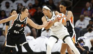 Chicago Sky forward/center Candace Parker looks to pass as Phoenix Mercury guard Diana Taurasi (3) defends during the first half of game 1 of the WNBA basketball Finals , Sunday, Oct. 10, 2021, in Phoenix.(AP Photo/Ralph Freso)