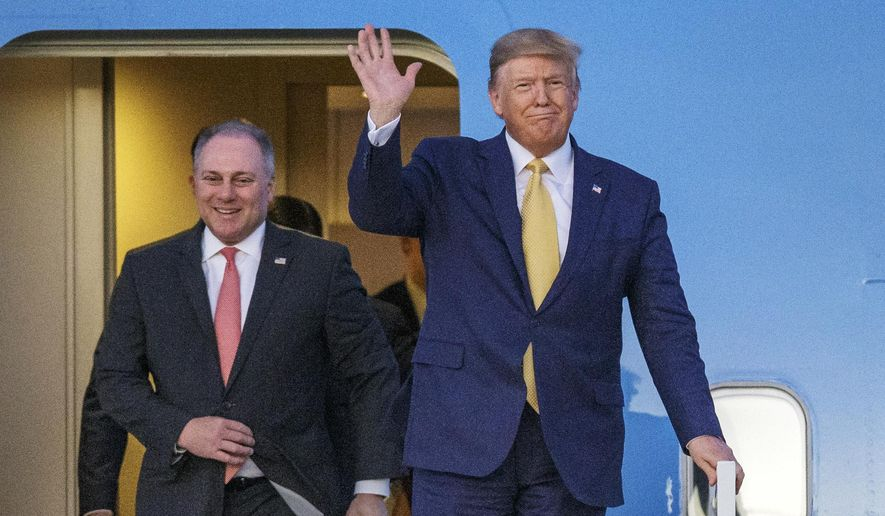 In this Friday, Oct. 11, 2019, file photo, President Donald Trump and House Minority Whip Steve Scalise, R-La., arrive in Lake Charles, La. In a television interview aired Sunday, Oct. 10, 2021, Scalise, the House's second-ranking Republican, stood by Trump's lie that Democrat Joe Biden won the White House because of mass voter fraud. (AP Photo/Brett Duke, File)