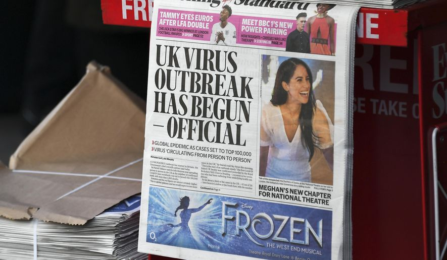 In this Friday, March 6, 2020, file photo, the front page of the Evening Standard is displayed at Bond Street Station, in London. A U.K. parliamentary report has concluded that Britain's Conservative government waited too long to impose a lockdown early in the COVID-19 pandemic. The report Tuesday, Oct. 12, 2021, says that caused the nation to miss a chance to contain the disease and led to thousands of unnecessary COVID-19 deaths. (AP Photo/Alberto Pezzali, fFile)