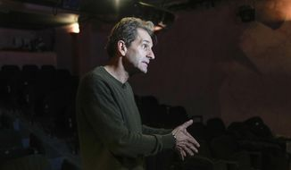 """Author and actor Laurent Martinez gestures as he speaks during an interview with The Associated-Press at """"Theo Theater"""" in Paris, Thursday, Oct. 7, 2021. French author and actor Laurent Martinez has been sexually abused by a priest. Over forty years later, he has chosen to make his story a theater play to show the devastating consequences and how speaking out can help overcoming the trauma. The play called """"Pardon?"""" is deeply inspired from the Martinez's own life, describing how he felt devoured from the inside and the difficulties of daily life after being abused. (AP Photo/Michel Euler)"""