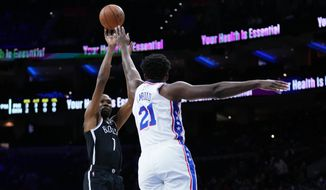 Brooklyn Nets' Kevin Durant, left, goes up for a shot against Philadelphia 76ers' Joel Embiid during the first half of a preseason NBA basketball game, Monday, Oct. 11, 2021, in Philadelphia. (AP Photo/Matt Slocum) **FILE**