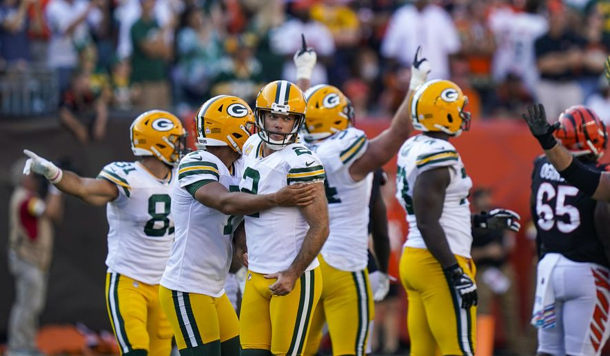 Green Bay Packers kicker Mason Crosby (2) celebrates after a winning field goal during overtime in an NFL football game against the Cincinnati Bengals in Cincinnati, Sunday, Oct. 10, 2021. The Packers defeated the Bengals 25-22 in overtime. (AP Photo/Bryan Woolston) **FILE**