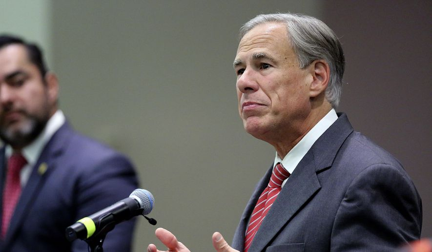Texas Gov. Greg Abbott speaks before he signs Texas SB 576, an anti-smuggling bill that enhances the criminal penalty for human smuggling when a payment is involved, at McAllen City Hall on Wednesday, Sept. 22, 2021, in McAllen, Texas. (Joel Marinez/The Monitor via AP) **FILE**