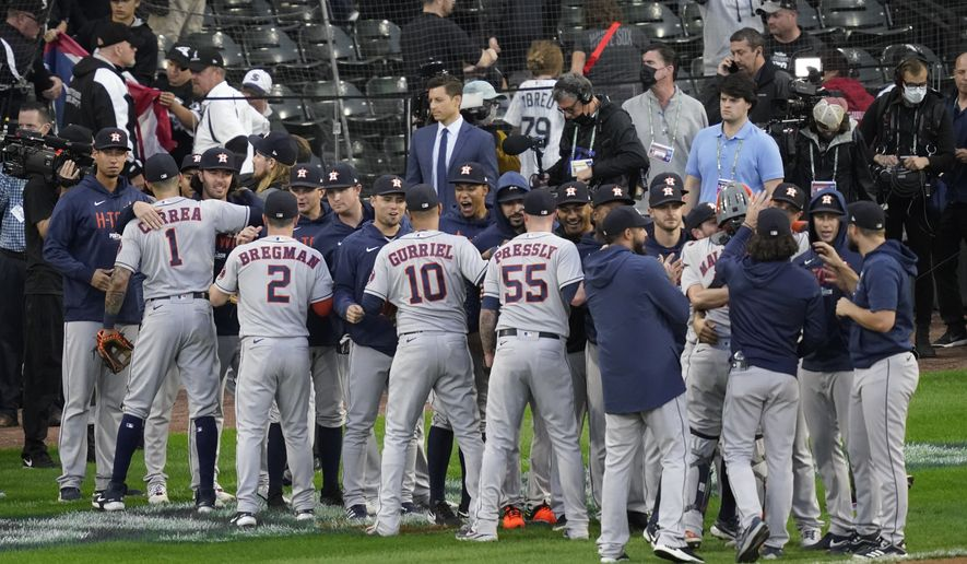 Houston Astros players celebrate beating the Chicago White Sox 10-1 in Game 4 of a baseball American League Division Series Tuesday, Oct. 12, 2021, in Chicago. (AP Photo/Charles Rex Arbogast)