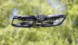 U.S. political and security concerns about the world's dominant consumer drone-maker, China-based DJI, have opened the door for Skydio and other companies to pitch their drones for government and business customers. (AP Photo/Jeff Chiu) ** FILE **