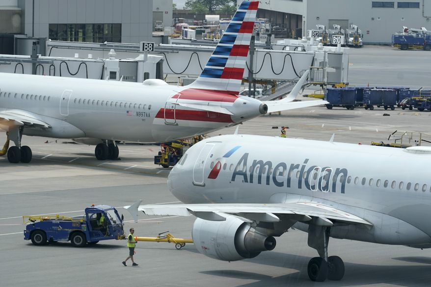 American Airlines passenger jets prepare for departure, Wednesday, July 21, 2021, near a terminal at Boston Logan International Airport, in Boston. (AP Photo/Steven Senne) ** FILE **