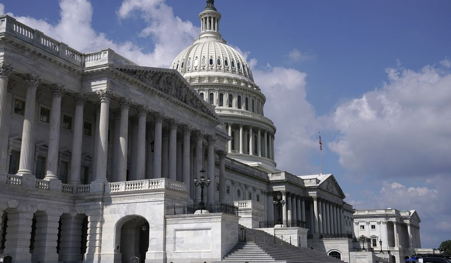 This Sept. 18, 2021, file photo shows the East Front of the U.S, Capitol in Washington. Members of the House are scrambling to Washington to pass a short-term lift of the nation's debt limit. The vote Tuesday will ensure the federal government can continue fully paying its bills into December. House Democrats are expected to have enough votes on their own to ensure that President Joe Biden can sign the bill into law this week. (AP Photo/J. Scott Applewhite, File)