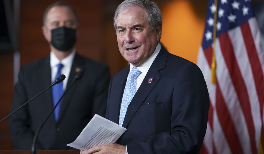 In this Sept. 21, 2021, photo House Budget Committee Chair John Yarmuth, D-Ky., joined at left by House Intelligence Committee Chairman Adam Schiff, D-Calif., talks to reporters at the Capitol in Washington.  Yarmuth, who as chairman of the House Budget Committee has played a key role in pushing for President Joe Biden's efforts to expand the nation's social safety net, announced Tuesday, Oct. 12,  that he will not seek another term next year.(AP Photo/J. Scott Applewhite) **FILE**