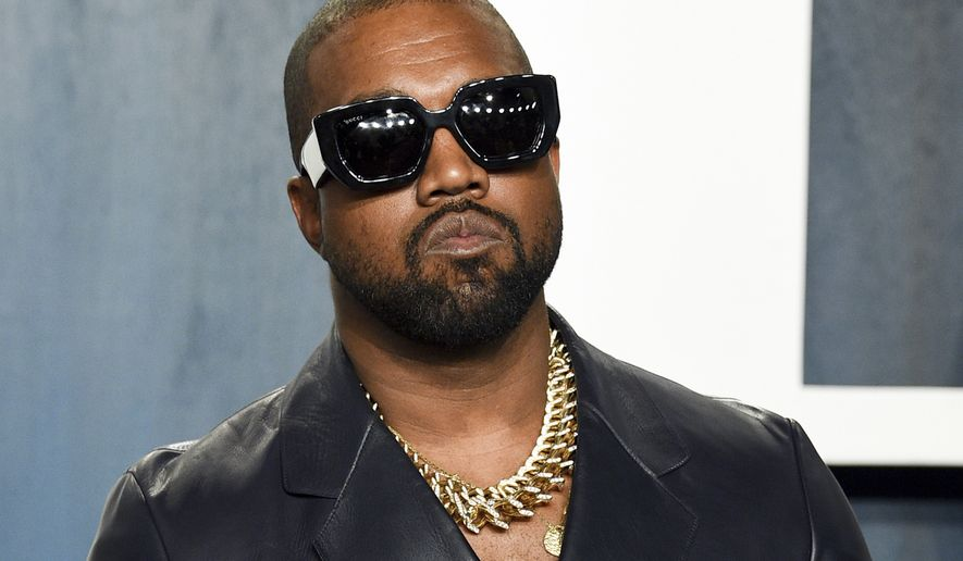 FILE - In this Feb. 9, 2020, file photo, Kanye West arrives at the Vanity Fair Oscar Party in Beverly Hills, Calif. Rapper, music producer and clothing entrepreneur West is selling his ranch and business properties in northwestern Wyoming. The West Ranch went on the market Monday, Oct. 11, 2021, for $11 million. (Photo by Evan Agostini/Invision/AP, File)