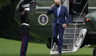 President Joe Biden salutes as he steps off of Marine One on the South Lawn of the White House in Washington, Monday, Oct. 11, 2021. He and first lady Jill Biden spent the weekend at their home in Wilmington, Delaware. (AP Photo/Susan Walsh)