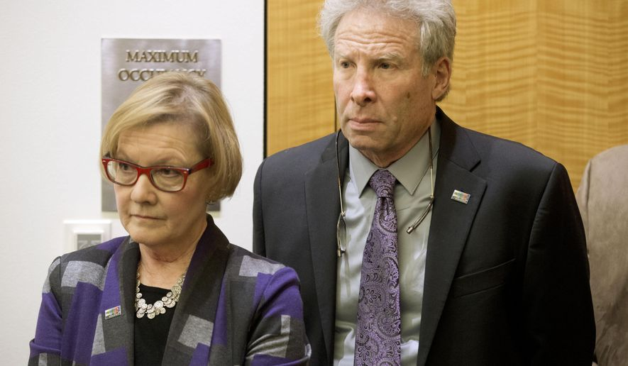 FILE - In this Jan. 29, 2016 file photo, Andy Parker and his wife, Barbara, listen as Virginia Gov. Terry McAulliffe announces a compromise on a set of gun bills at the Capitol in Richmond, Va. The family of a slain journalist is asking the Federal Trade Commission, Tuesday, Oct. 12, 2021,  to take action against Facebook for failing to remove online footage of her shooting death. Andy Parker says the company is violating its own terms of service in hosting videos on Facebook and its sibling service Instagram that glorify violence. His daughter, TV news reporter Alison Parker, and cameraman Adam Ward were killed by a former co-worker while reporting for Roanoke, Virginia's WDBJ-TV in August 2015. (AP Photo/Steve Helber)