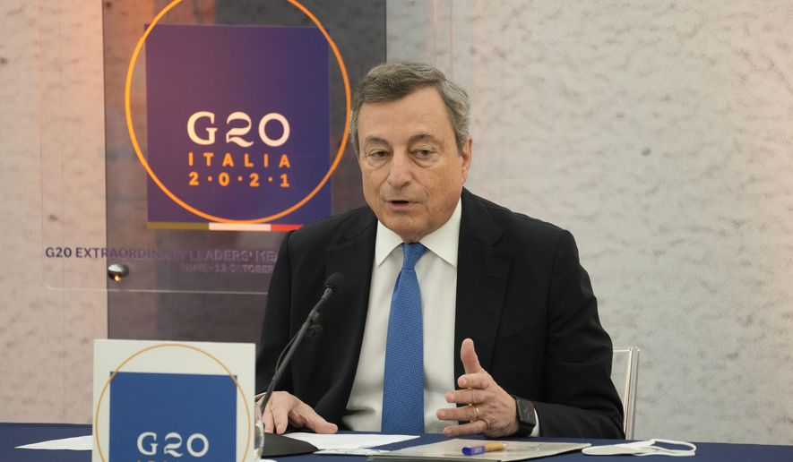 Italian Premier Mario Draghi meets the journalists during a press conference at the end of a virtual summit of the Group of 20 dedicated to Afghanistan in Rome, Tuesday, Oct. 12, 2021. The European Union announced a 1 billion euro support package in support for the Afghan people on Tuesday but warned that humanitarian aid in itself will not suffice to keep hunger at bay as winter comes closer. (AP Photo/Gregorio Borgia)